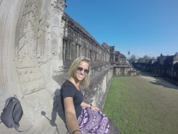 Sitting on the side of the back of Angkor Wat!