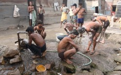 Men bathing in the streets with murky water